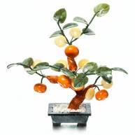 Дерево с мандаринами и монетами